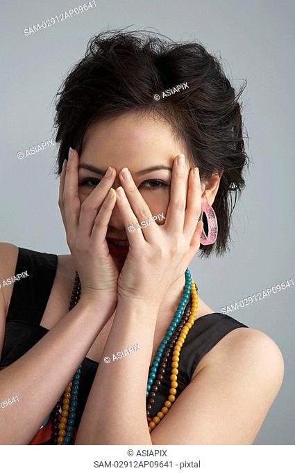 woman playing peekaboo with camera