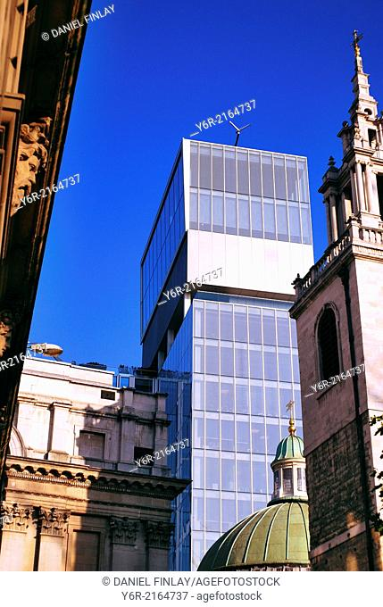Old and new buildings in the City of London international business district on a sunny day in England