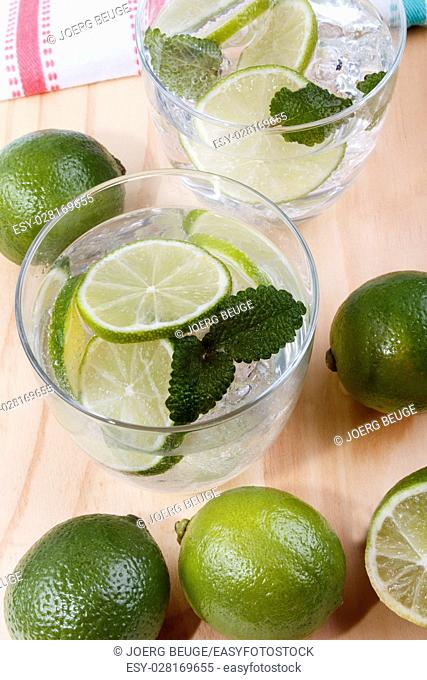 refreshing drink, mineral water with organic lime and lemon balm