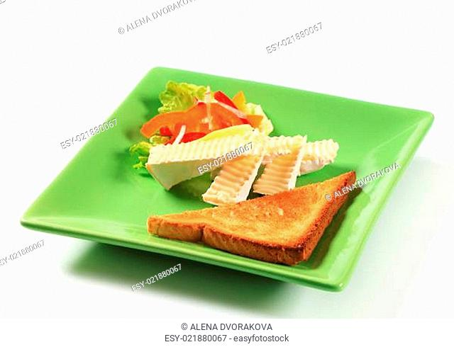 Toast and white rind cheese