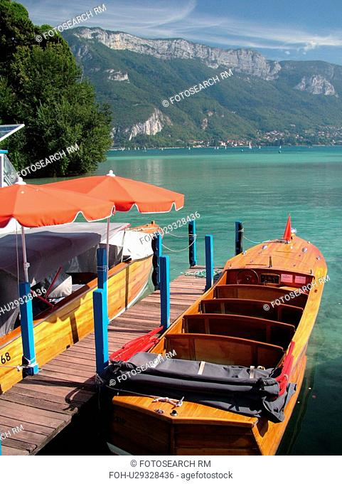 France, Annecy, Haute-Savoie, Rhone-Alpes, Europe, Lake Annecy, Lac d' Annecy, wooden excursion boats, Lakeside park, mountains