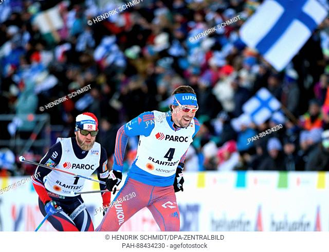 Sergey Ustiugov of Russia (R) races ahead of Martin Johnsrud Sundby of Norway in the men's 2 x 15km cross-country race at the 2017 Nordic World Ski...