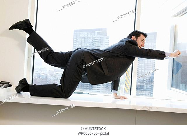 Businessman exercising in an office