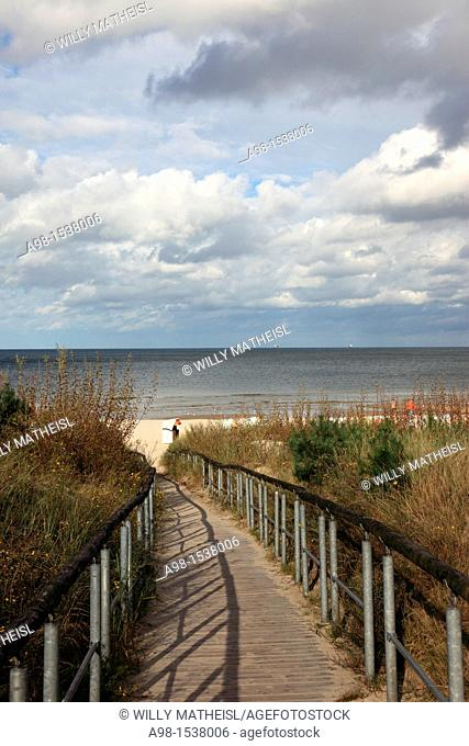 wooden path over sand dunes to beach on the island Usedom, Western Pomerania, Germany