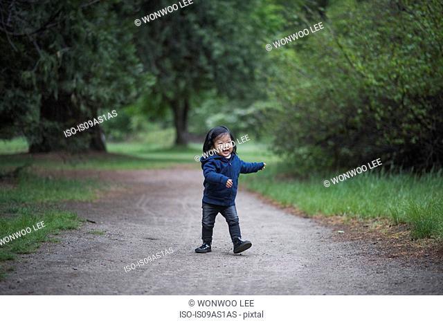 Female toddler walking on forest path, Yosemite National Park, California, USA