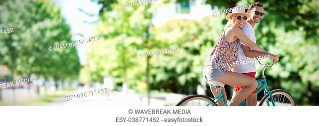 Composite image of cute couple on a bike ride digital composite image