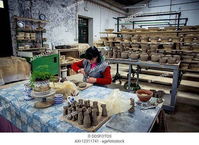Woman molding some pottery at Vieira Pottery; Lagoa, Sao Miguel, Azores, Portugal