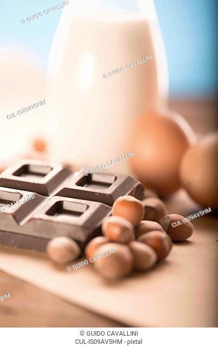 Hazelnuts, chocolate cubes, eggs