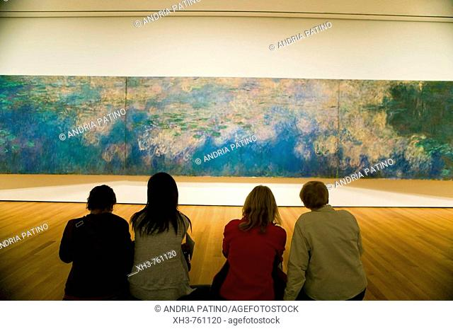 Visitors appreciating Claude Monet's Reflections of Clouds on the Water-Lily Pond, c  1920