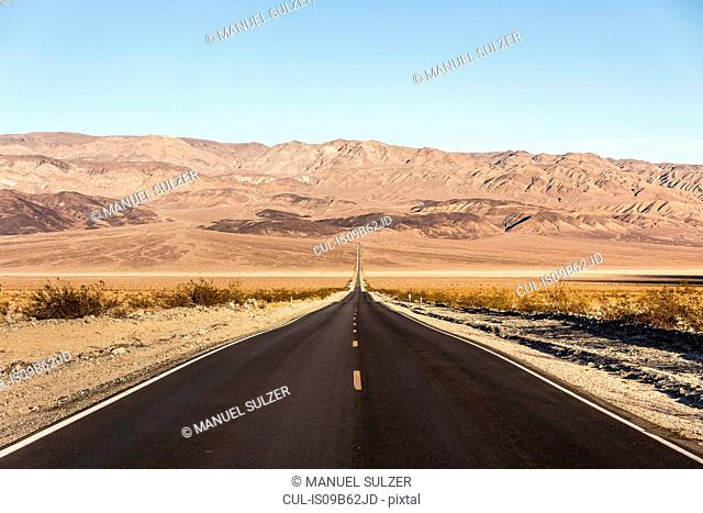 Landscape with straight road in Death Valley National Park, California, USA
