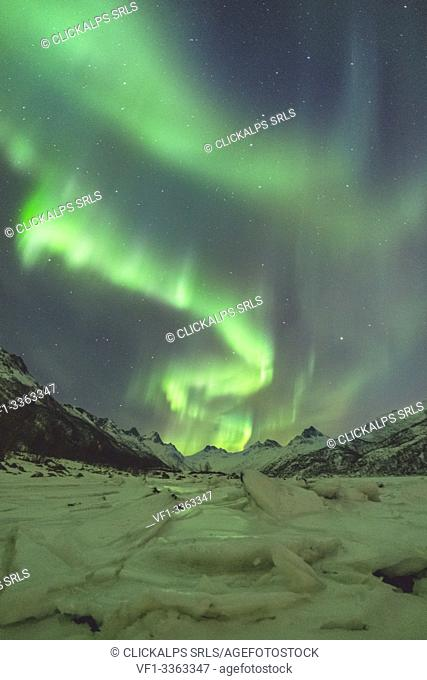Northern lights with mountains and ice in the foreground. Kleppstad, Nordland county, Northern Norway, Norway