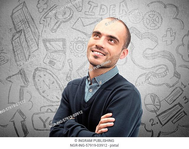 Young business man thinking of his plans closeup face portrait and sketches overhead