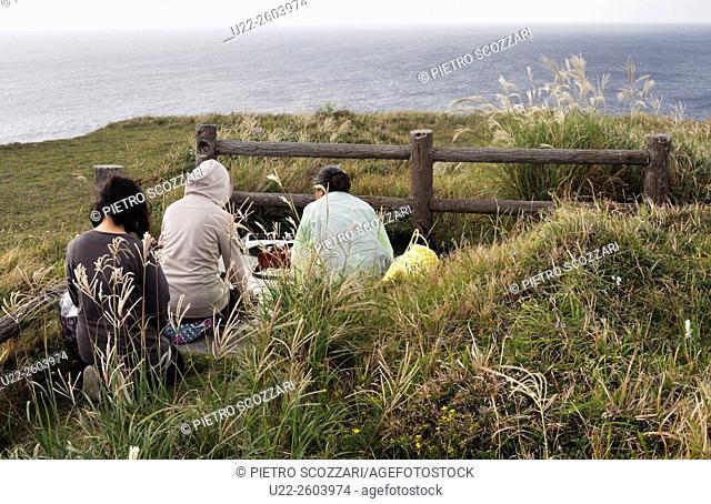 Aguni Island (Okinawa, Japan): people praying for their ancestors towards the sea at Cape Mahana