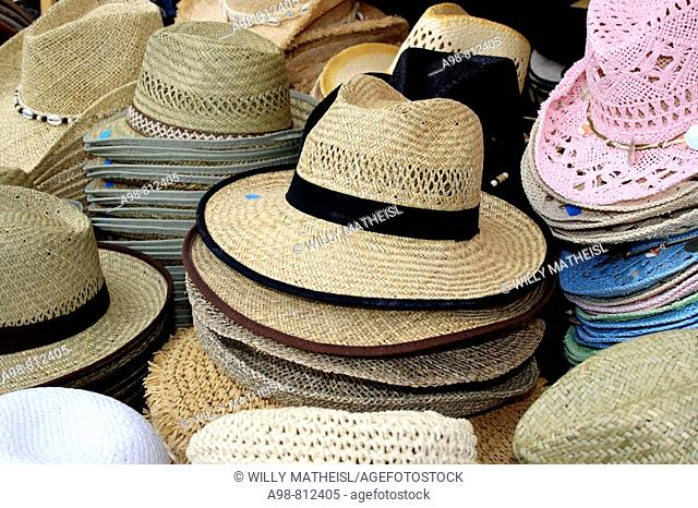piles of straw hats at display Munich, Bavaria, Germany