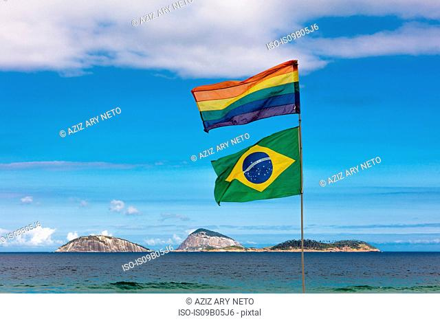 Flags flying on beach, Ipanema, Cagarras islands, Rio de Janeiro, Brazil