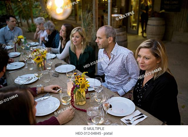 Friends enjoying outdoor dinner harvest party