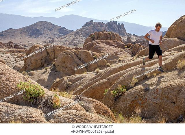 Man Trail Running In The Alabama Hills National Recreation Area, Lone Pine, California, Usa