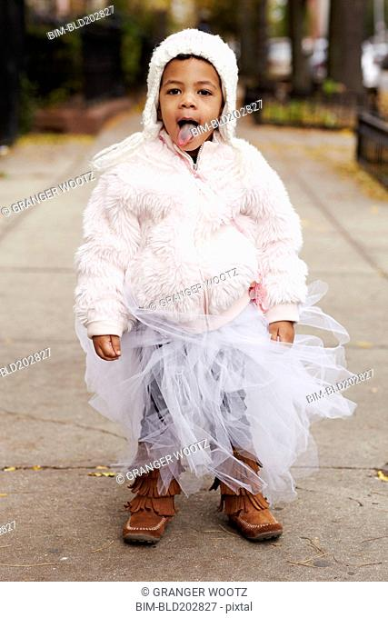 Mixed race girl wearing fairy costume