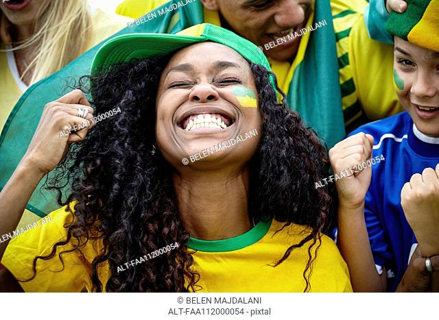 Brazilian football fans cheering at match