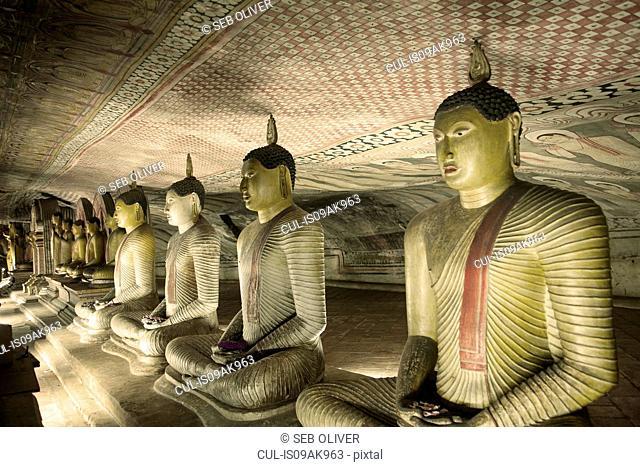 Row of seated buddhas, Rock Temple, Dambulla, Sri Lanka