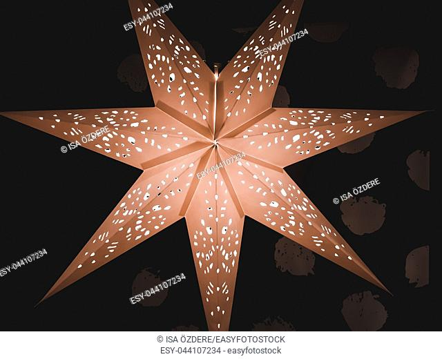 View of large big star decorated with light bulbs on a dark background for Christmas