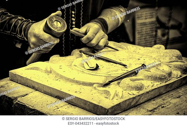 Carving stone in a traditional way, craftsmanship detail, shaping the stone