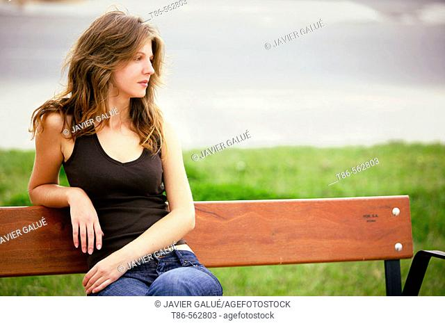 Young woman sitting on bench