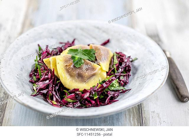 Red cabbage salad with walnut ravioli