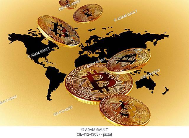 Golden Bitcoins over global map