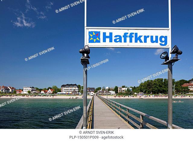Wooden pier / jetty / Seebrücke Haffkrug along the Bay of Lübeck, Schleswig-Holstein, Germany