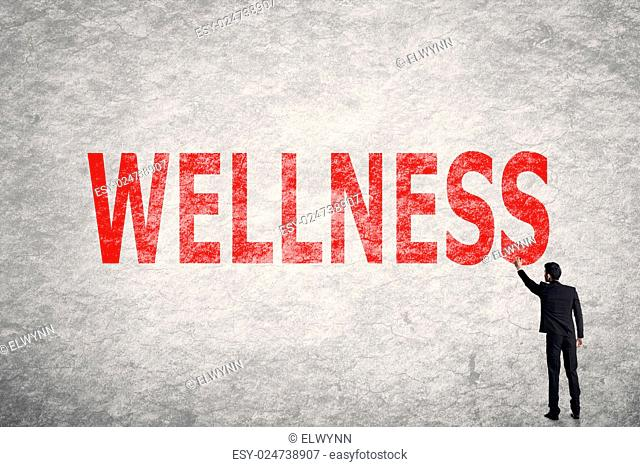 Asian businessman write text on wall, Wellness