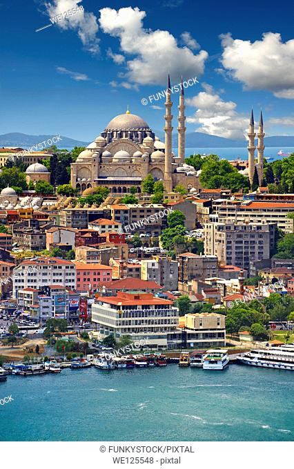 The Suleymaniye Mosque (Süleymaniye Camii, 1550-1558) on the Third Hill with a ferries on the banks of the Golden Horn in the foreground, Istanbul Turkey