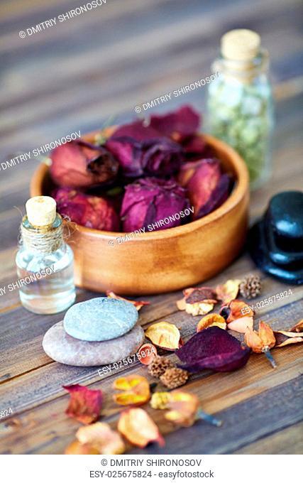 Dry petals, pebbles and oil massage