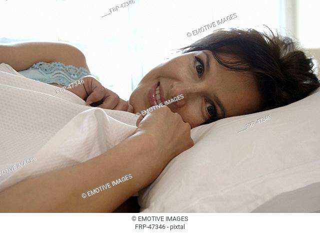 woman lying in her bed