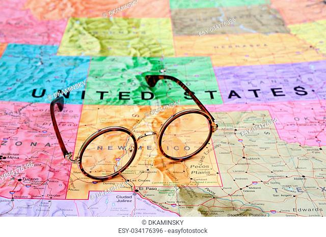 Photo of glasses on a map of USA. Focus on New Mexico. May be used as illustration for traveling theme