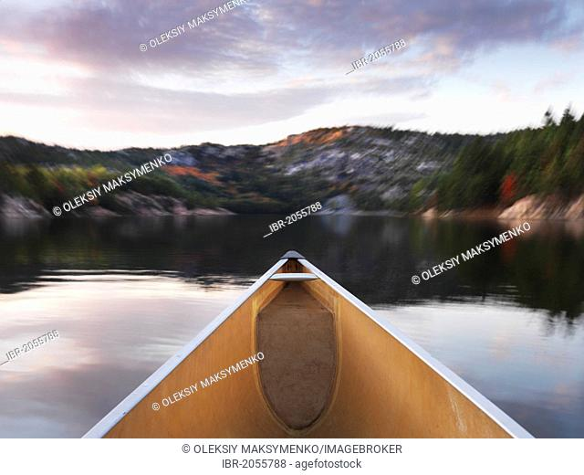 Canoeing on lake George in fall, Killarney Provincial Park, Ontario, Canada
