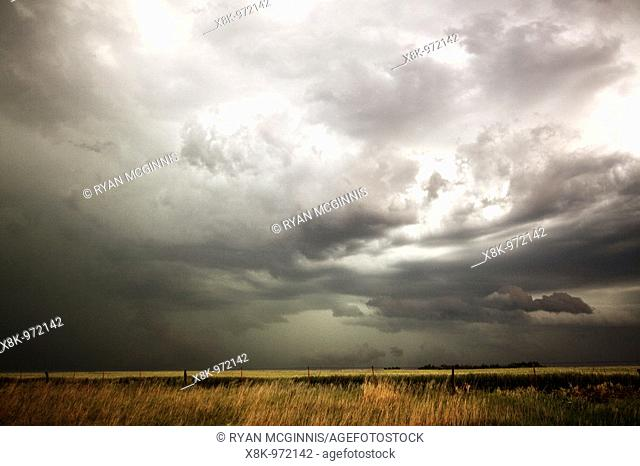 Dark clouds over prarie grass  Shot during Project Vortex 2  Project Vortex 2 is a two year National Science Foundation funded science mission to study...