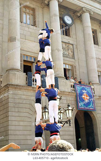 """""""Castellers"""" (catalan tradition), human tower during the Mercè Festival in front of the city hall. Plaça de Sant Jaume. Barcelona. Spain"""