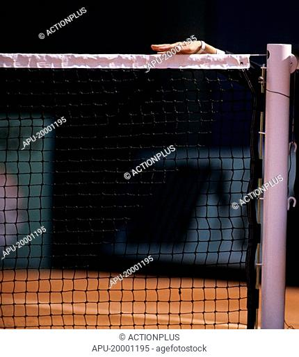 Close up of referees hand on a tennis net