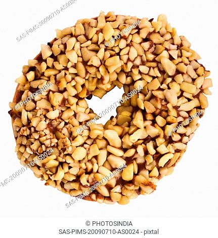 Close-up of a donut garnished with nuts