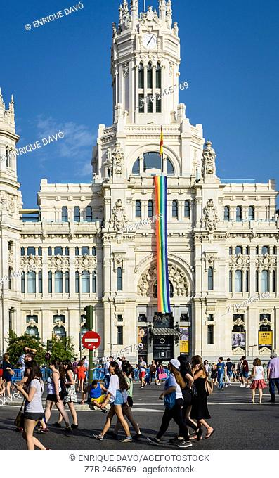 Vertical view of a rainbow flag in Correos palace, Madrid city, Spain