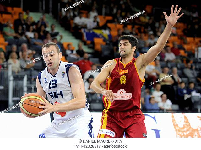 Macedonia's Vojdan Stojanovski (R) vies for the ball with Bosnia's Dalibor Persic during the Basketball DBB Supercup between Bosnia-Herzegovina and Macedonia at...
