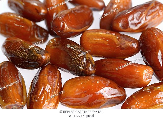 Close up of ripe sweet date palm fruit on white background
