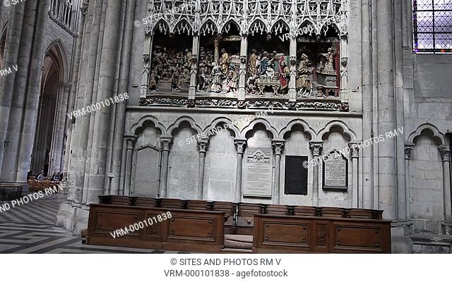 LS. TILT up. Interior: Jesus and the moneylenders in the Temple, west side of the North Transept. The Cathedral is in the High Gothic or Classical French style