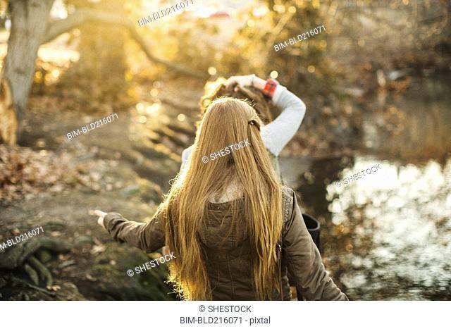 Caucasian women walking in park