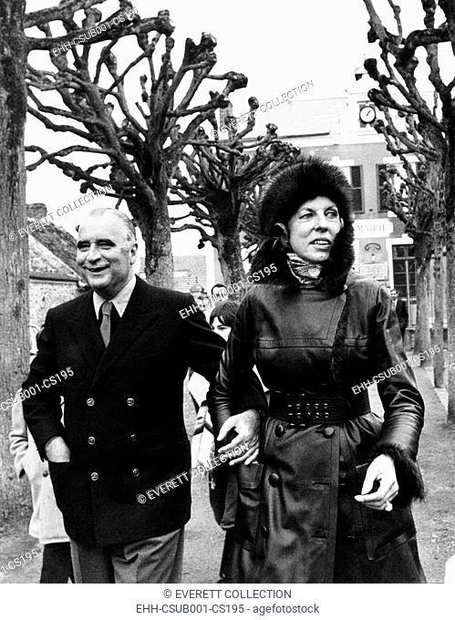 French President and Claude Pompidou arriving to vote in the French municipal elections. March 14, 1971. Mme. Pompidou wears a fashionable mink fur hat and...
