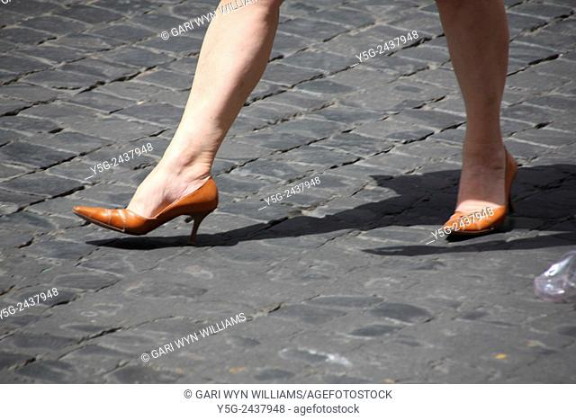 Woman wearing high heel shoes in Rome Italy