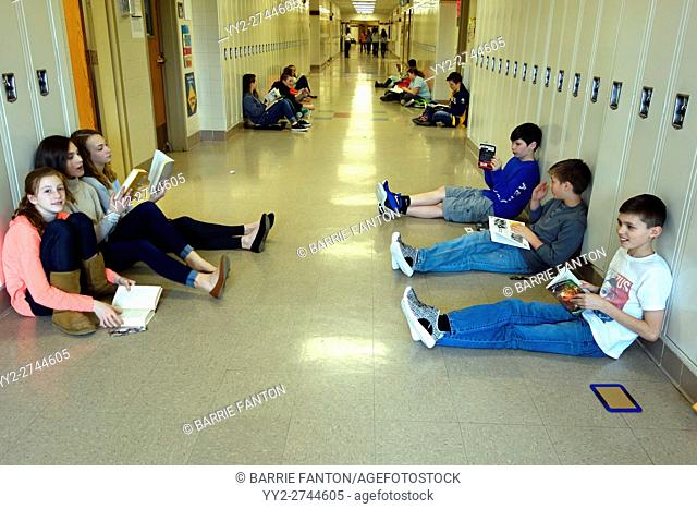 6th Graders Reading in Hallway, Wellsville, New York, USA