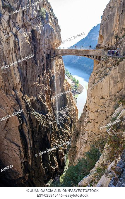 Visitors crossing the suspension bridge at Gaitanes Gorge, Malaga, Spain
