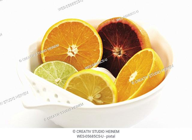 Sliced citrus fruits in bowl